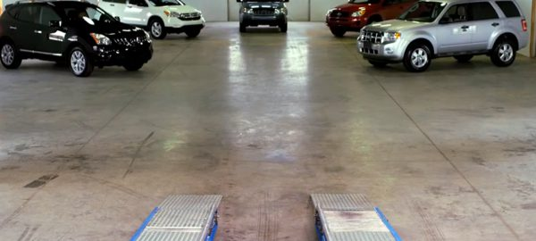 SUVs warehouse testing rolling road