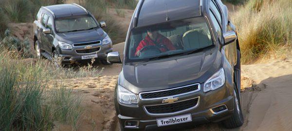 Brown Chevrolet Trailblazer on dunes South Africa Knysna