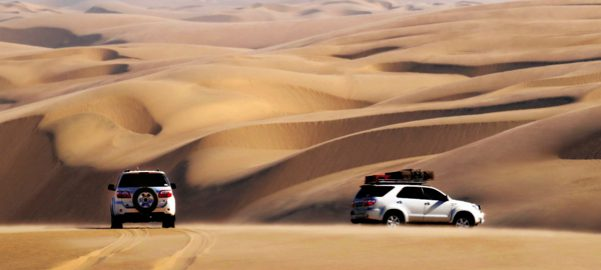 sand desert dunes two Toyota fortuners wide angel