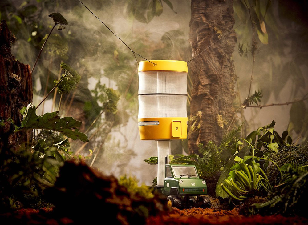 The yellow capsule is a small living space that can be pulled into the trees.