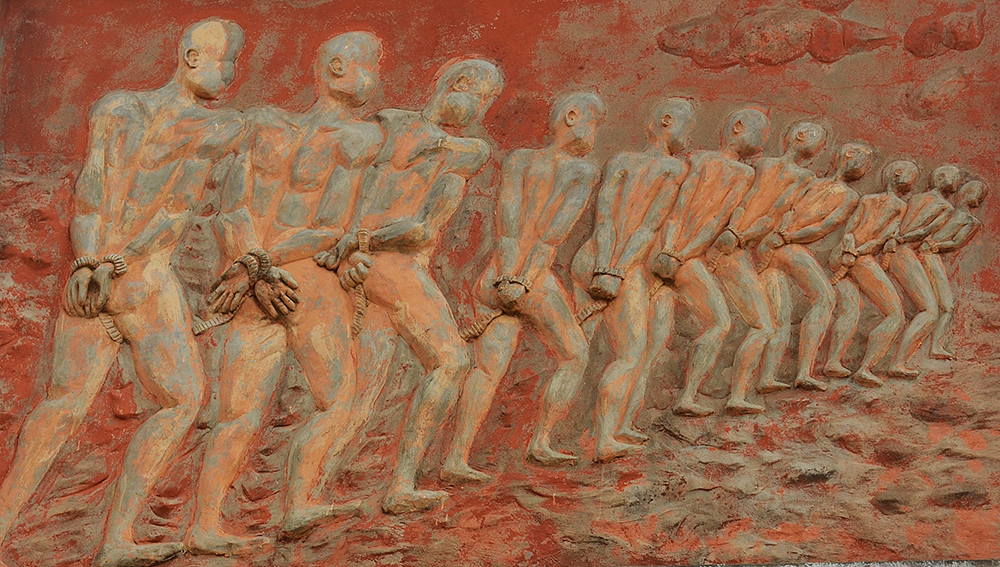 Gate of No Return – Ouidah, Benin: A bas-relief of slaves on the imposing Gate of No Return; it was slaves from here that carried the Voodoo belief system to Haiti, Louisiana, Cuba and Brazil.